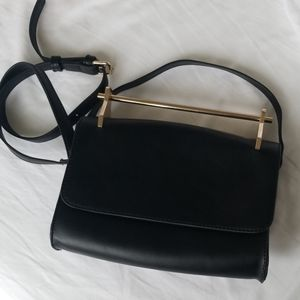 Black faux leather bag with gold handle